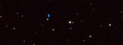 The blue color of three white dwarfs